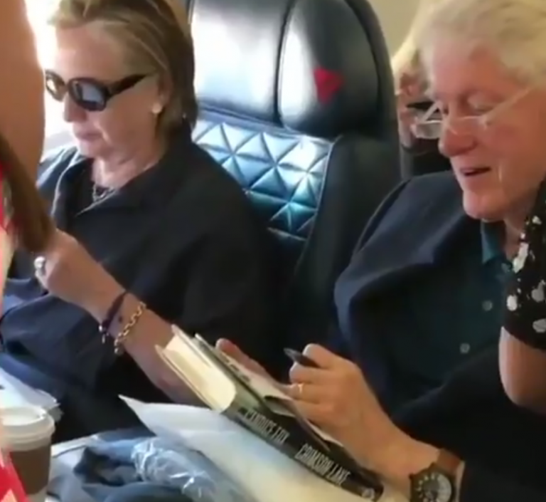 Clintons fly aboard commercial airliner, Bill caught reading fiction 'rape' thriller in flight