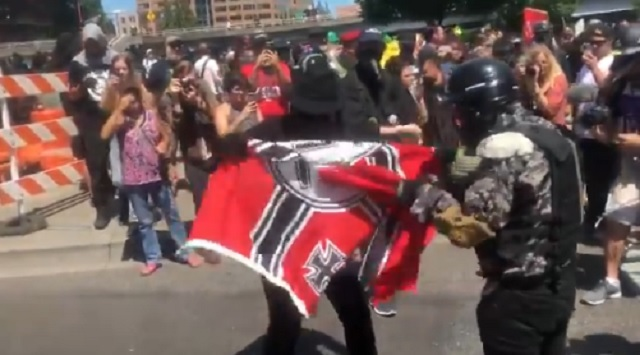 Photo of Antifa Bring Their Own Nazi Flag to Patriot Prayer March, Burn It And Claim They're Protesting 'Nazis'
