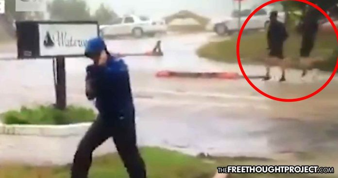 Photo of WATCH: Weather Channel Reporter Busted Faking Strong Wind as 2 Men Walk By Like Nothing Is Happening