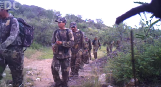 Photo of Illegals Armed With AR-15s And AK-47s Filmed Invading America Through Southern Border