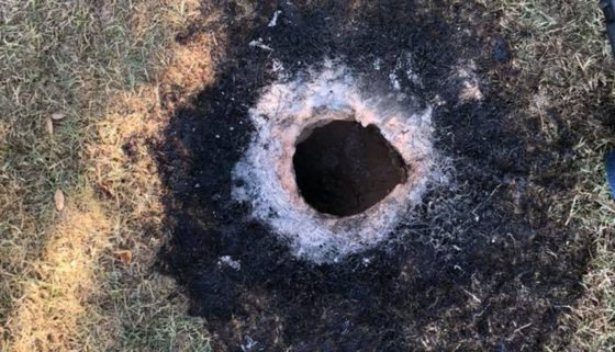 "Photo of We've ""Ruled Out"" Satan: Officials Baffled By Mysterious Flaming Hole in Arkansas"