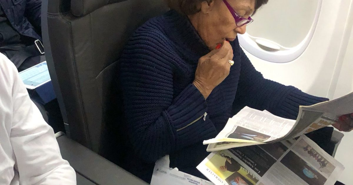 Photo of While Federal Employees Are Without A Paycheck, Photos Capture Rep. Maxine Waters In First Class Reading About Herself