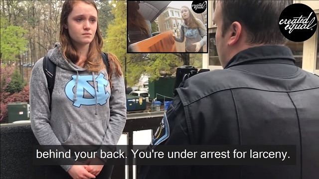 Photo of Video: Empowered Feminist Steals Pro-Lifer's Sign, Gets Arrested, Starts Crying