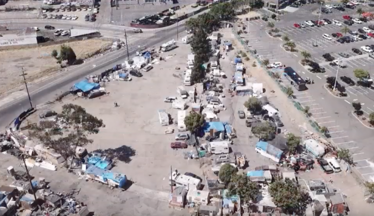 City of Oakland fails to provide homeless with portable toilets as raw sewage flows onto streets