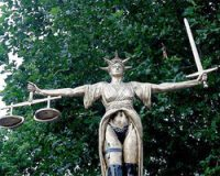 Lady Justice is a Two Dollar Hooker