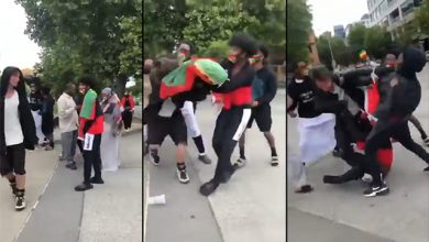 Photo of Seattle: African Immigrants Flying Flag of Terrorist Separatist Group Beat White Man in The Street