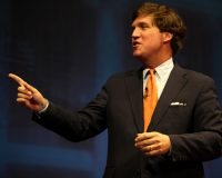 Tucker Carlson warns that the Democrat Party has launched war on half of America